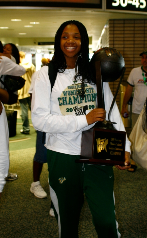 Jessica Lawson stands at Tampa International Airport with the WNIT championship trophy. ORACLE FILE PHOTO